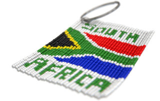 A traditional zulu beaded keyring with the words and flag of south africa on an isolated white background - 3D render